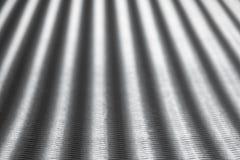 L'argento ha ondulato il fondo di carta con sfuocatura nei precedenti Colpo orizzontale fotografia stock