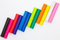 L'argilla di arte attacca i colori dell'arcobaleno Immagine Stock