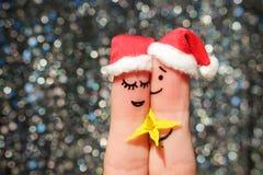 L'art de doigt d'un couple heureux célèbre Noël Image stock