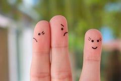 L'art de doigt de la famille pendant la querelle, une autre femme est heureux Photographie stock
