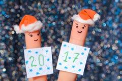 L'art de doigt des couples célèbre Noël Photo stock