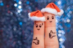 L'art de doigt des couples célèbre Noël Images libres de droits