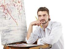 L'artista pensieroso inventa una nuova immagine Isolato sopra bianco Immagini Stock