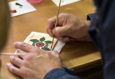 L'artiste peint la peinture de Gorodets photo stock