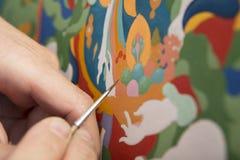 L'artiste peint une icône bouddhiste Image stock