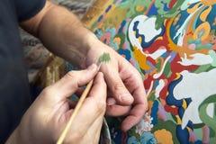L'artiste peint une icône bouddhiste Photo stock