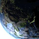 L'Asie de l'Est sur terre la nuit - fond océanique évident Photos libres de droits