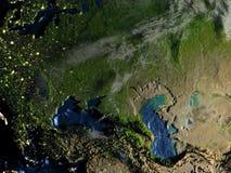 L'Asie occidentale sur terre la nuit - fond océanique évident Image libre de droits