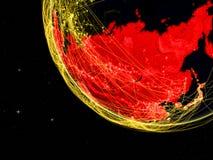 L'Asie sur la terre foncée dans l'espace illustration stock