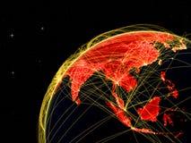 L'Asie sur le globe foncé dans l'espace illustration de vecteur