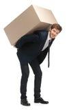 L'assistente di negozio trasporta il pacchetto Fotografie Stock