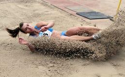 L'athlète concurrencent dans le saut triple Photo stock