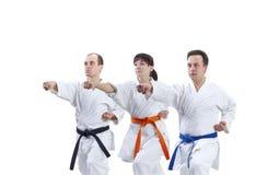 L'athlète de l'adulte trois battent le bras de poinçon Photos libres de droits
