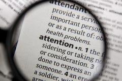 L'attention de mot ou d'expression dans un dictionnaire photo libre de droits
