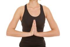 L'attrezzatura nera di forma fisica della donna medita il corpo Immagine Stock
