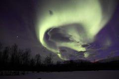 L'aurore/lumière du nord dans Abisko, Suède Photos stock