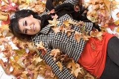 L'automne laisse la femme Photo stock