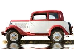 L'automobile antica di colore bianco e rosso Fotografia Stock Libera da Diritti