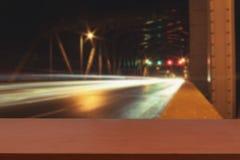 L'automobile della luce di velocità del fondo sulla strada Immagini Stock Libere da Diritti