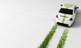 L'automobile elettrica con erba rintraccia, rappresentazione 3d Fotografia Stock