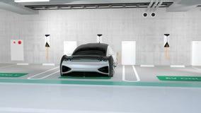 L'automobile elettrica di colore d'argento che fa pagare nella stazione di carico individua nel parcheggio sotterraneo stock footage