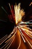 L'automobile si illumina nella sfuocatura di movimento con effetto dello zoom Fotografia Stock Libera da Diritti