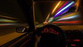 L'automobile si muove alla grande velocità alla notte Fotografia Stock Libera da Diritti