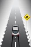 L'automobile sportiva sta frenando quando vedi i segni di rischio Fotografia Stock