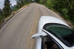 L'automobile sta muovendosi Fotografie Stock Libere da Diritti