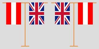 L'Autriche et le R-U Les drapeaux verticaux autrichiens et britanniques Couleurs officielles Proportion correcte Vecteur illustration libre de droits