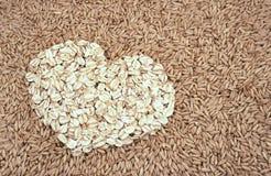 L'avena semina e avena-si sfalda cuore Immagine Stock Libera da Diritti