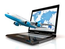 L'avion et l'ordinateur portatif Photographie stock