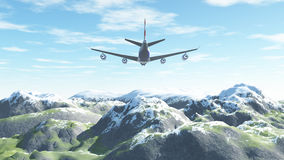 L'avion vole au-dessus des montagnes couronnées de neige Photographie stock