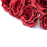 L bouquet of red roses on a white background. Artificial bouquet of red roses on a white background Stock Photo