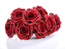 L bouquet of red roses on a white background. Artificial bouquet of red roses on a white background Stock Image