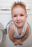 L boy from washer Royalty Free Stock Photo