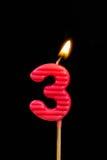 l'Compleanno-anniversario esamina in controluce il numero 3 Fotografia Stock Libera da Diritti