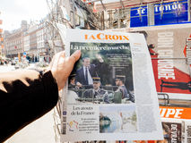L Croix reporting handover ceremony presidential inauguration of. PARIS, FRANCE - MAY 15, 2017: Man buys La Croix French newspaper reporting handover ceremony Royalty Free Stock Images
