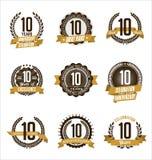L'or d'anniversaire Badges la 10ème célébration d'années Photographie stock libre de droits
