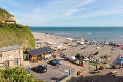 Öl Devon England UK med folk och fiskeutrustning Fotografering för Bildbyråer