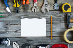 L different tools on boards. Stock Photos