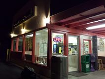 L & L Drive-Inn. Waimanalo - September 16, 2014: L & L Drive-Inn at Night. Island-themed fast-food chain whose menu features traditional Hawaiian plate lunches royalty free stock images