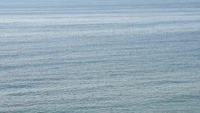 L'eau calme d'océan banque de vidéos