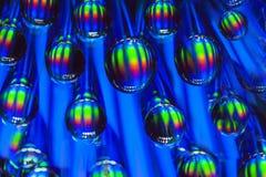 l'eau colorée de baisses de fond Photographie stock
