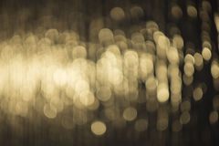 L'eau d'or allume le fond Photographie stock libre de droits