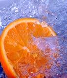 L'eau de éclaboussement orange Image stock