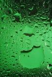 L'eau sur la glace verte Photo stock