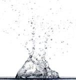 L'eau tombant dans l'eau Photographie stock libre de droits