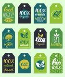 L'eco de vecteur, logo organique carde des calibres Sains manuscrits mangent de rétros logotypes réglés Vegan, nourriture naturel Photo stock