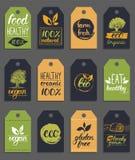 L'eco de vecteur, logo organique carde des calibres Sains manuscrits mangent de rétros logotypes réglés Vegan, nourriture naturel Photo libre de droits